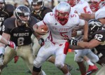 Absegami defenders Christian Henchy (8) and Tyler Grace (52) target Saint Joseph's running back C.J. LaFragola.