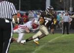 Absegami running back Vinny Nelson outruns Saint Joseph linebacker Zach McGuckin.