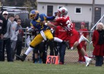 Saint Joseph defensive back Rocco Ordille grabs onto Marist running back D'Ondre Robinson.