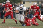 Hammonton running back Justin Fucetola breaks the tackle of Saint Joseph defensive back Cody Sampson.