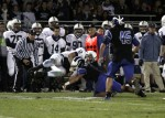 Hammonton defensive back David Maimone brings down Shawnee quarterback Michael Welsh.
