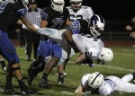Hammonton defensive end Tyler Armor tackles Shawnee running back Jake Parola.