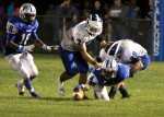 Oakcrest wide receiver Brandon Roberson attempts to recover his own fumble.