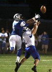 Oakcrest wide receiver Brandon Roberson and Hammonton defensive back David Maimone reach for the ball.