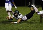 Mainland running back Qwin Vitale dives for a first down.