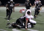 Saint Jospeh tight end LaQuay Brown loses is helmet fighting for some extra yards.