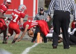 Saint Joseph running back Cody Sampson dives across the goalline.